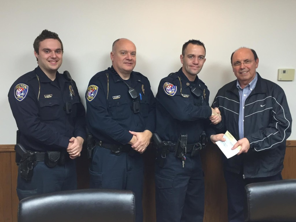 Members of the Fulton, MO police department donating to the Vincent Gurucharrri Foundation.